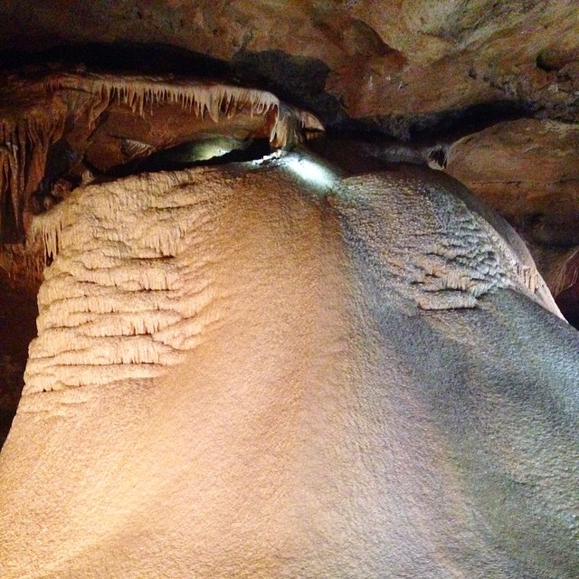 This is a 27,000 year old flow stone discovered at Inner Space Caverns - the light at the top is where the water flows down it and it continues to grow. I'm a geek - I know it. #TMOM