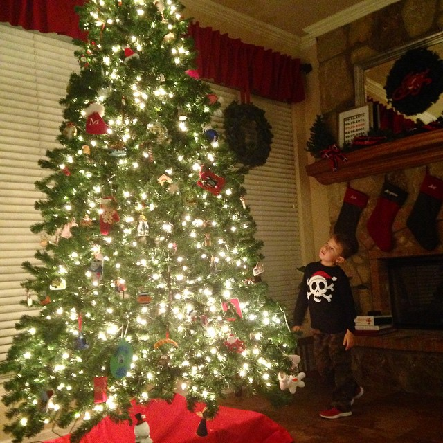 Though decorating last week seemed a little early to us, it was nice to come home to a fully decorated house today. And to watch him walk around the tree discovering all his favorite ornaments.