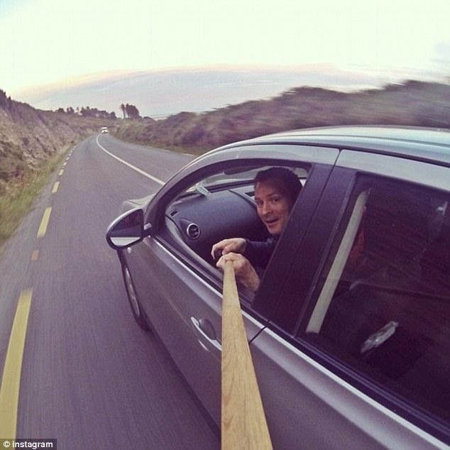 1411621494807_wps_41_Selfie_on_a_stick_People_