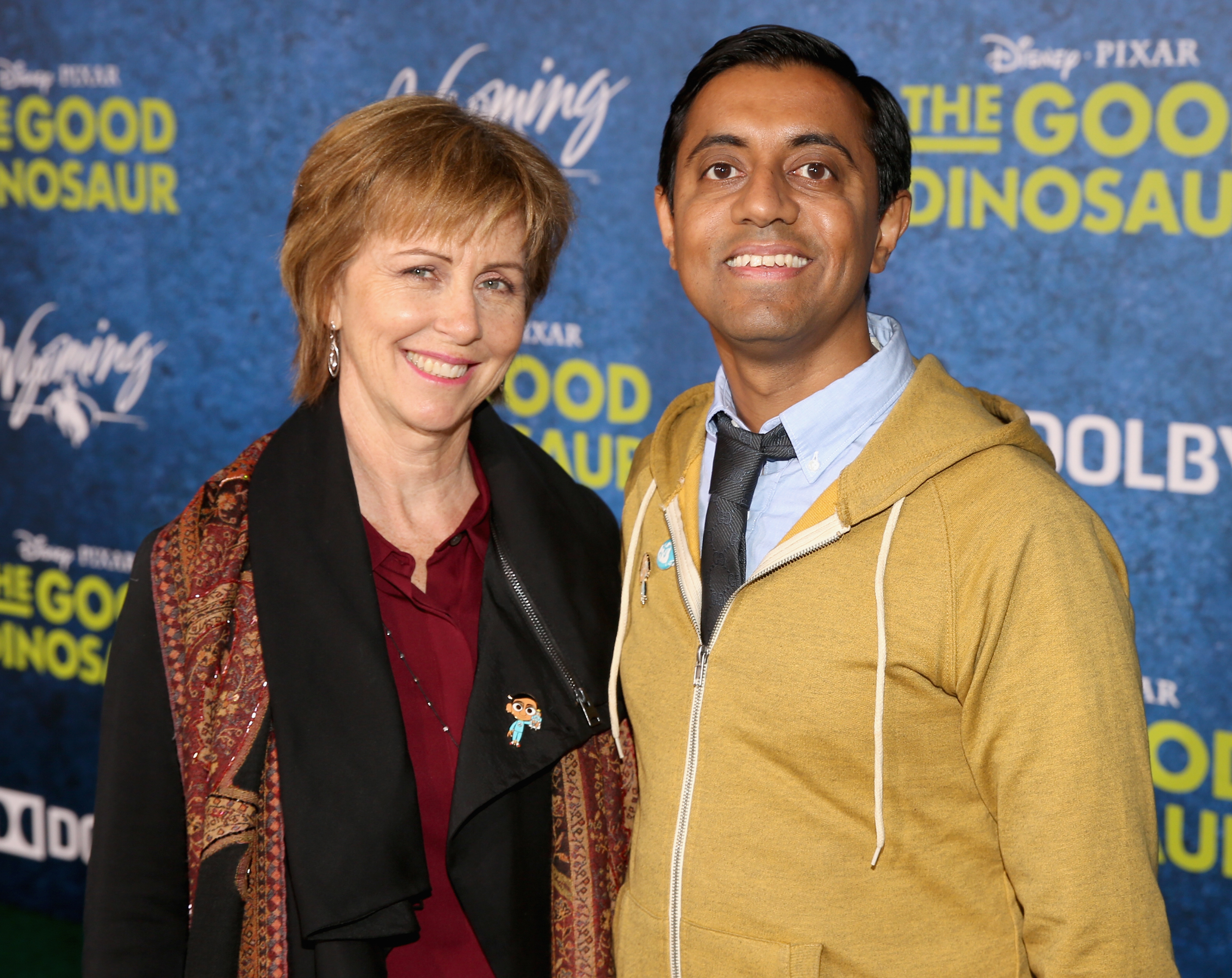 "HOLLYWOOD, CA - NOVEMBER 17: ""Sanjay's Super Team"" Producer Nicole Paradis Grindle (L) and director Sanjay Patel attend the World Premiere Of Disney-Pixar's THE GOOD DINOSAUR at the El Capitan Theatre on November 17, 2015 in Hollywood, California. (Photo by Jesse Grant/Getty Images for Disney) *** Local Caption *** Sanjay Patel; Nicole Paradis Grindle"